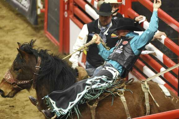 Jacobs Crawley of Boerne, Texas, rides out of the chute to win the saddle bronc riding event during the finals of the San Antonio Stock Show & Rodeo in the AT&T Center on Saturday, Feb. 24, 2018.