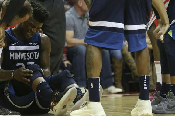 Minnesota Timberwolves guard Jimmy Butler (23) appears in pain while holding his right knee during the third quarter of the NBA game against the Houston Rockets at Toyota Center on Friday, Feb. 23, 2018, in Houston. The Houston Rockets defeated the Minnesota Timberwolves 120-102. ( Yi-Chin Lee / Houston Chronicle )
