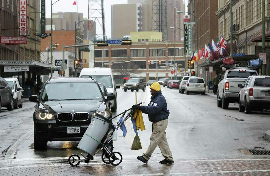 A Centro Ambassador crosses Broadway at Houston St. This is a much needed service, funded through a taxpayer-supported public improvement district. A recent Express-News article raised disturbing issues on whether those funds were mixed with another entity's mission to lobby the council. Photo: Bob Owen /San Antonio Express-News / ©2018 San Antonio Express-News