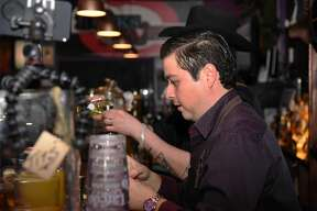 Bartender works on a cocktail at On The Rocks Tavern.