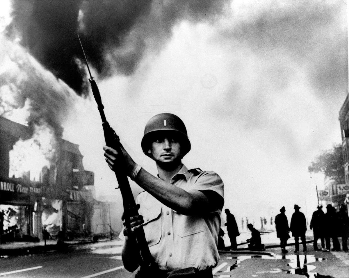 A National Guardsman patrols a Detroit intersection during the July 1967 riots. That summer, 150 cases of civil unrest erupted across the country.