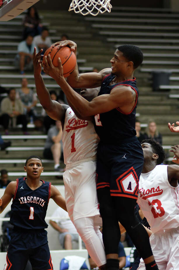 Atascocita senior Kobe Wilson, right, controls a rebound against Alief Taylor senior guard Kavin Ezekwe (1) in the 2nd quarter of their Region III-6A Area Playoff matchup at Phillips Fieldhouse in Pasadena on Feb. 23, 2018. (Photo by Jerry Baker/Freelance) Photo: Jerry Baker, Freelance / Freelance