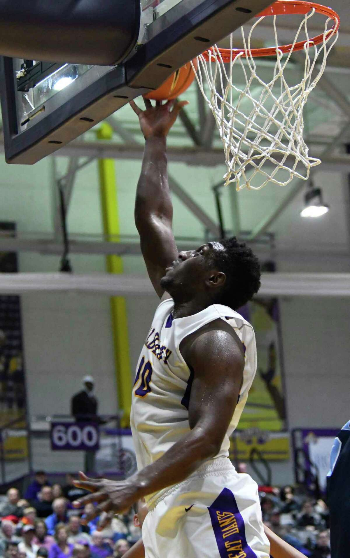 UAlbany's Travis Charles takes a shot on a breakaway during a game against Maine on Saturday, Feb. 24, 2018, at SEFCU Arena in Albany, N.Y. UAlbany finished out with a win over Maine 89-79. (Jenn March, Special to the Times Union)