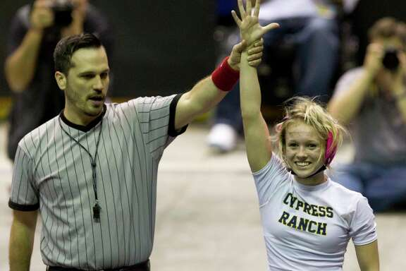 The official makes it official Saturday at the Berry Center: Cypress Ranch's Kaitlyn Banas is a state champion at 95 pounds.