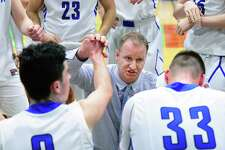 Saratoga head coach Matt Usher with players during a time out in their Class AA quarterfinal game against LaSalle Saturday Feb. 24, 2018 in Troy, NY. (John Carl D'Annibale/Times Union)