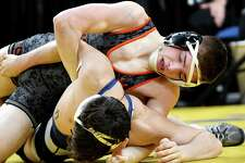 Orion Anderson of Schuylerville, top, battles Vince Miceli of Port Jefferson to claim the Div II 126 class state wrestling title during the NYSPHSAA Wrestling Championships on Saturday, Feb. 24, 2018, at the Times Union Center in Albany, N.Y. (Will Waldron/Times Union)