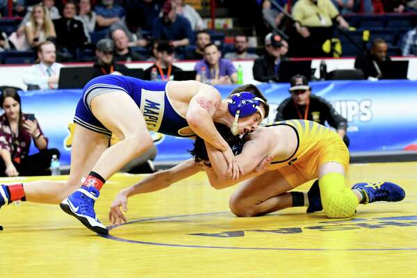 Trent Svingala of Maple Hill High School, left, takes on Brady Worthing of Tioga to claim the Div II 120 class state wrestling title during the NYSPHSAA Wrestling Championships on Saturday, Feb. 24, 2018, at the Times Union Center in Albany, N.Y. (Will Waldron/Times Union)