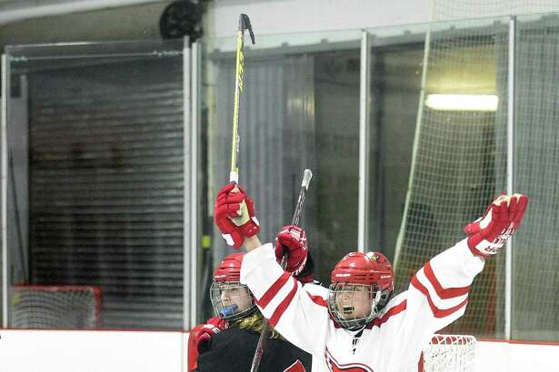 Greenwich's Emma Wingrove (12) scores the winning goal against New Canaan goalie Blythe Novick during the FCIAC Girls Ice Hockey Championship at the Darien Ice Rink on Saturday, Feb. 24, 2018 in Darien, Connecticut. Greenwich defeated New Canaan 2-1.
