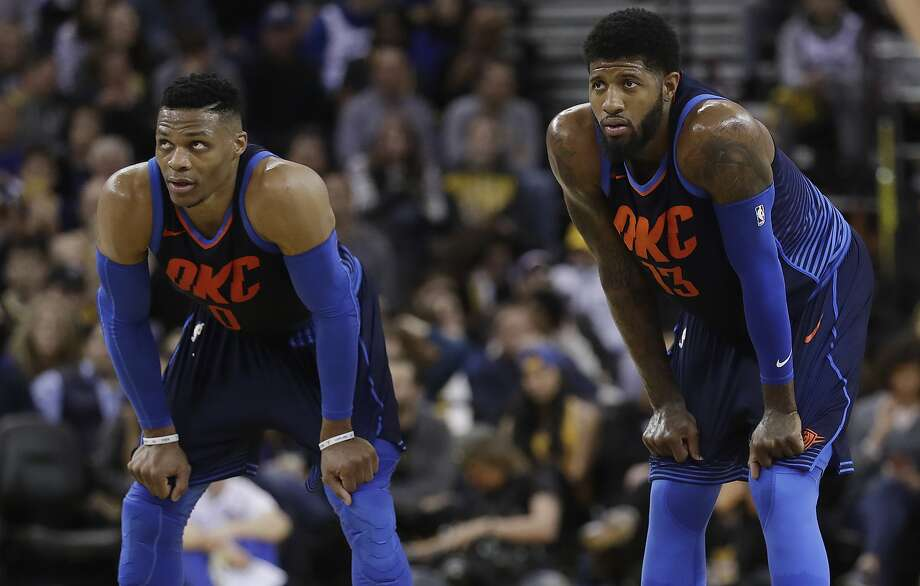 Oklahoma City Thunder's Paul George, right, and Russell Westbrook during the first half of an NBA basketball game against the Golden State Warriors Saturday, Feb. 24, 2018, in Oakland, Calif. (AP Photo/Marcio Jose Sanchez) Photo: Marcio Jose Sanchez, Associated Press