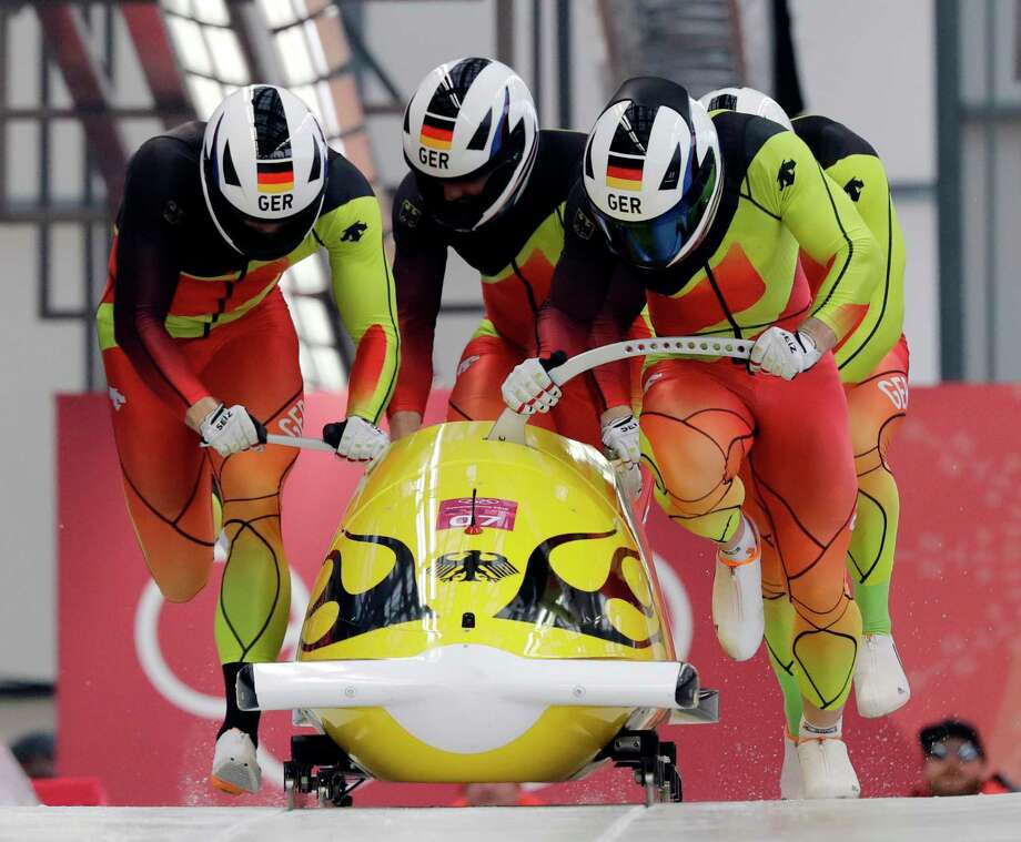 Driver Francesco Friedrich, Candy Bauer, Martin Grothkopp and Thorsten Margis of Germany start their third heat during the four-man bobsled competition final at the 2018 Winter Olympics in Pyeongchang, South Korea, Sunday, Feb. 25, 2018. (AP Photo/Wong Maye-E) Photo: Wong Maye-E / Copyright 2018 The Associated Press. All rights reserved