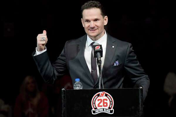 Former New Jersey Devils' Patrik Elias, of the Czech Republic, speaks during his jersey retirement ceremony before an NHL hockey game against the New York Islanders Saturday, Feb. 24, 2018, in Newark, N.J. (AP Photo/Bill Kostroun)