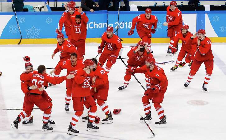 Olympic athletes from Russia celebrate after winning the men's gold medal hockey game against Germany, 4-3, in overtime at the 2018 Winter Olympics, Sunday, Feb. 25, 2018, in Gangneung, South Korea.