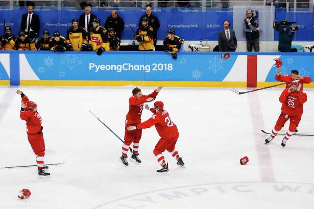 Olympic athletes from Russia celebrates after winning the men's gold medal hockey game against Germany, 4-3, in overtime at the 2018 Winter Olympics, Sunday, Feb. 25, 2018, in Gangneung, South Korea.