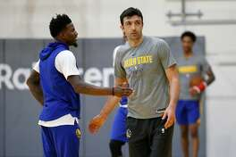 Jordan Bell, (left) and Zaza Pachulia at the Warriors practice facility in Oakland, Calif., on Fri. Feb. 23, 2018.