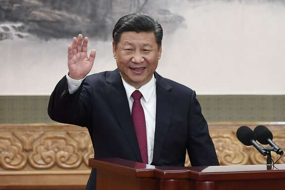 (FILES) This file photo taken on October 25, 2017 shows Chinese President Xi Jinping waving at the Great Hall of the People in Beijing. China's Communist Party is calling for the removal of presidential term limits, China's official news agency reported on February 25, 2018, paving the way for Xi Jinping to remain as head of state after 2023. / AFP PHOTO / WANG ZHAOWANG ZHAO/AFP/Getty Images