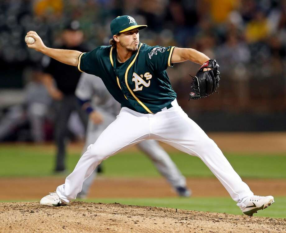 Oakland Athletics' relief pitcher Ryan Dull delivers pitch that Seattle Mariners' Danny Valencia hit for a 3-run home run in 7th inning during MLB game at Oakland Coliseum in Oakland, Calif., on Tuesday, September 26, 2017. Photo: Scott Strazzante / The Chronicle