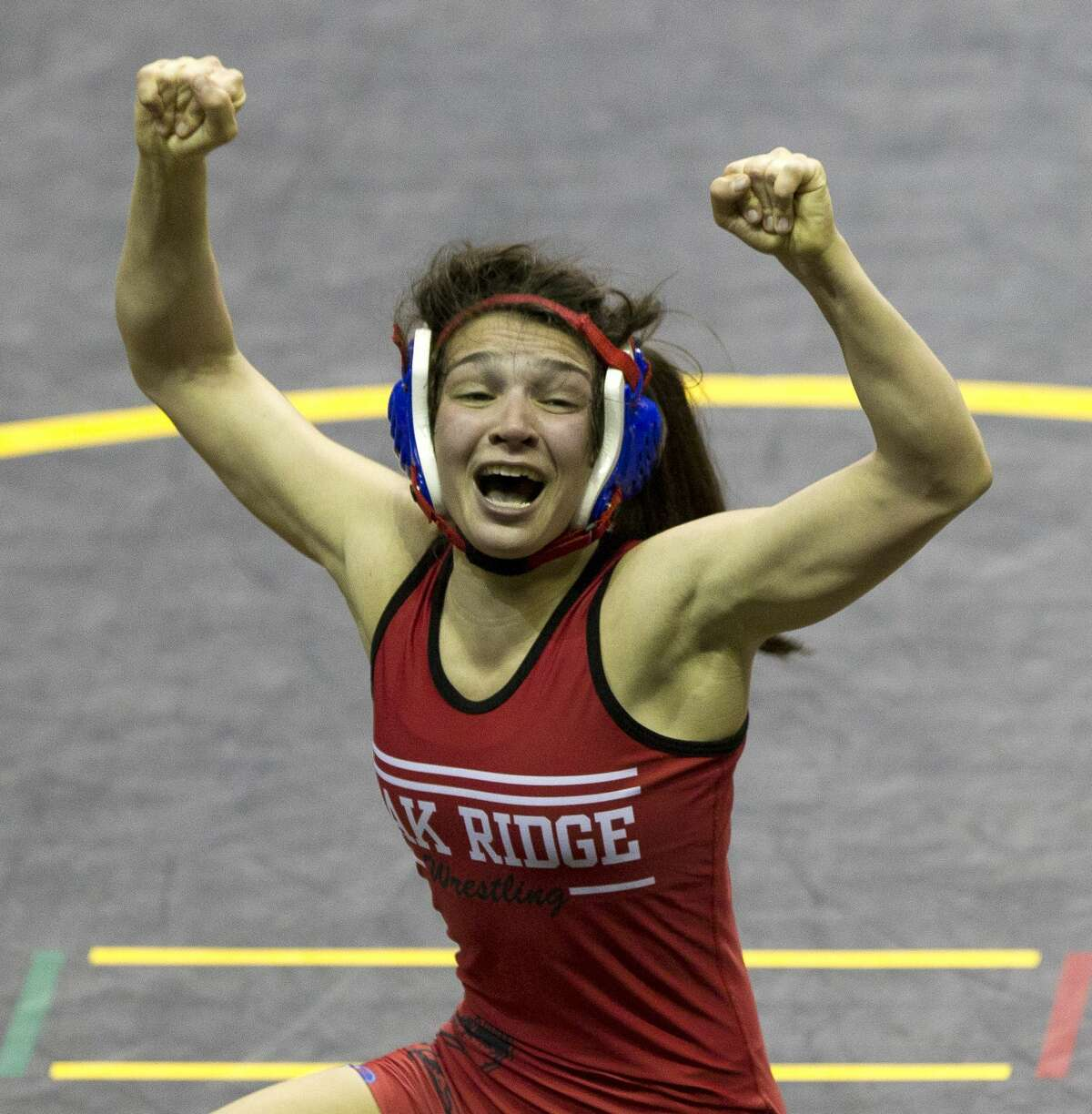 Annamarie Crixell of Oak Ridge reacts after winning third place in the Class 6A girls 110-pound weight class during the UIL State Wrestling Championships at the Berry Center, Saturday, Feb. 24, 2018, in Cypress.