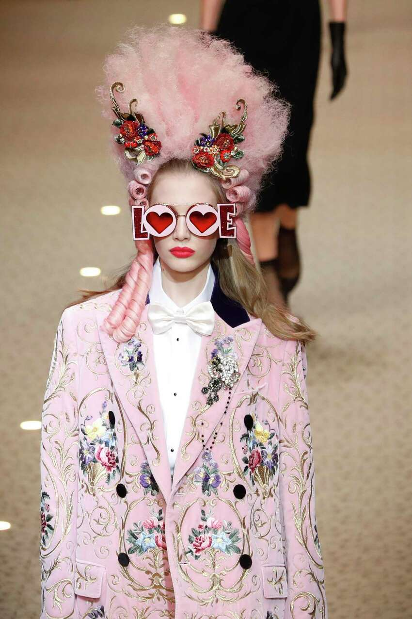 A model wears a creation as part of the Dolce & Gabbana women's Fall/Winter 2018-2019 collection, presented during the Milan Fashion Week, in Milan, Italy, Sunday, Feb. 25, 2018.
