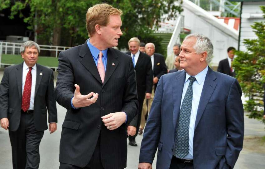 REP. SCOTT MURPHY, left, and NYRA President Charles Hayward appear Tueday at Saratoga Race Course. Hayward says NYRA needs $20 million. (John Carl D'Annibale / Times Union)