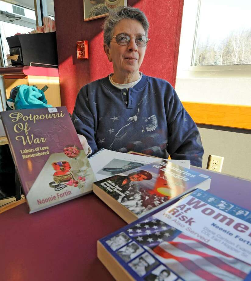 Noonie Fortin of Colonie with some of the books she has written.  (Skip Dickstein/Times Union) Photo: Skip Dickstein / 2008