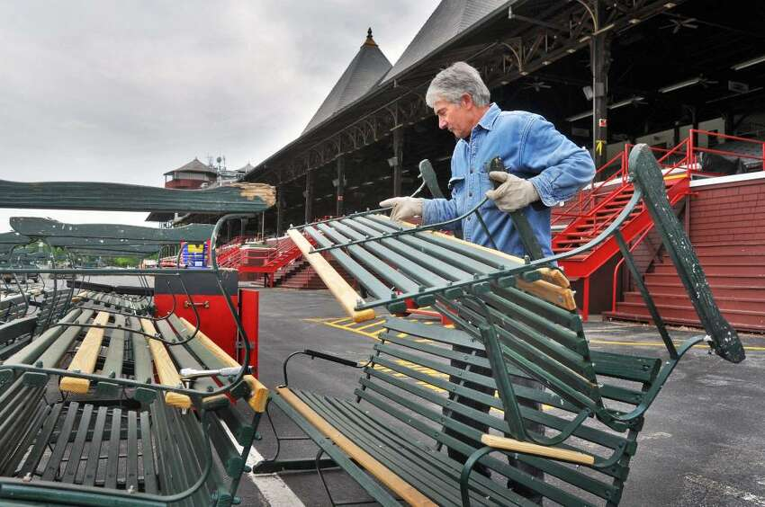 Bill Walczuk of NYRA's maintenence crew works on the 800-900 benches on the grandstands apron at Saratoga Race Course Tuesday morning May 18, 2010.