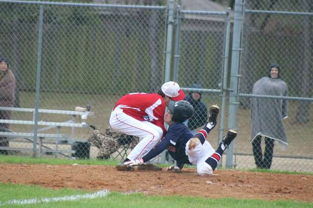 FBCA pitcher Josh Towe collides with Bay Area Christian's Jackson Collins at home plate during the team's season opener recently. Towe is expected to bolster the Warriors roster this spring.
