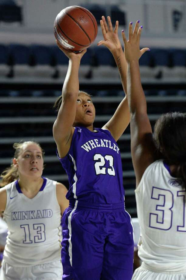 Ke'Ahundra Lowery (23) of Wheatley makes a shot during the fourth quarter of the championship game in the Houston ISD Varsity Girls Tournament between the Kinkaid Falcons and the Wheatley Wildcats on Saturday December 2, 2017 at Delmar Fieldhouse, Houston, TX. Photo: Craig Moseley, Staff / ©2017 Houston Chronicle