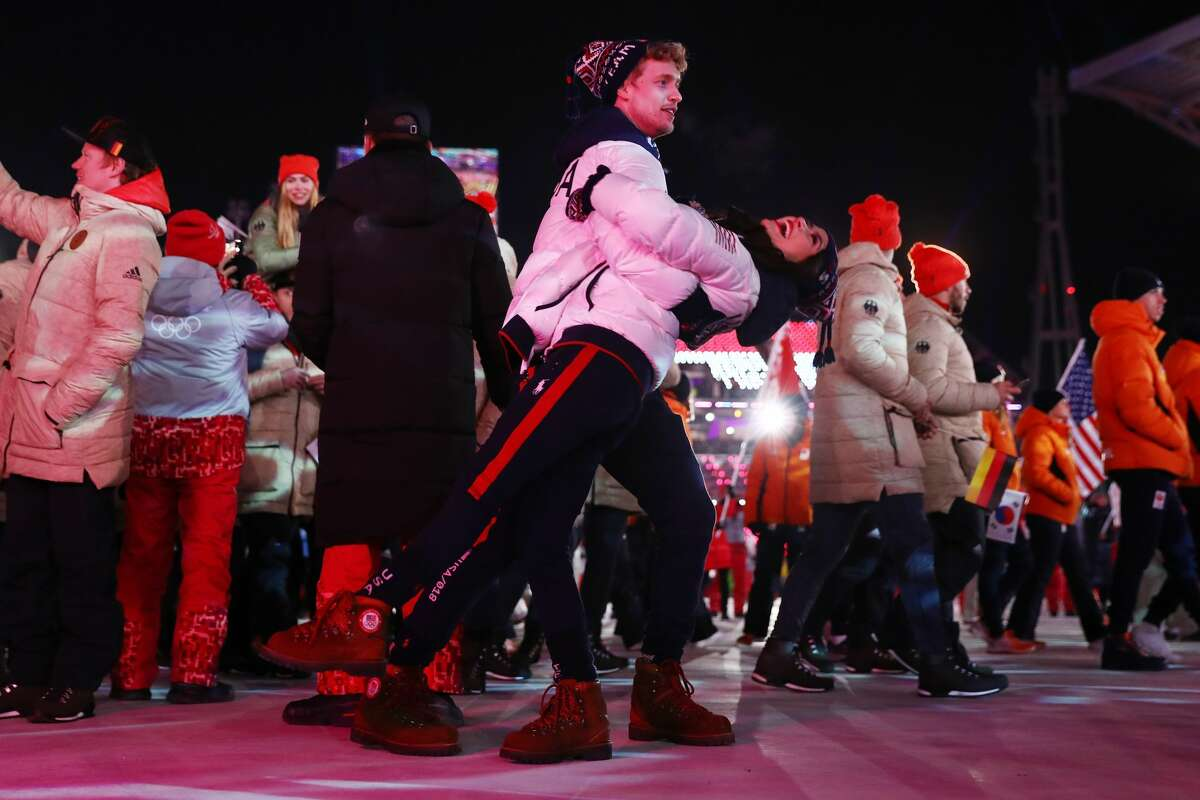 PYEONGCHANG-GUN, SOUTH KOREA - FEBRUARY 25: Madison Chock and Evan Bates walk with Team USA in the Parade of Athletes during the Closing Ceremony of the PyeongChang 2018 Winter Olympic Games at PyeongChang Olympic Stadium on February 25, 2018 in Pyeongchang-gun, South Korea. (Photo by Dan Istitene/Getty Images)