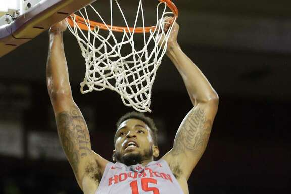 The University of Houston Devin Davis makes a dunk against East Carolina University during the first half of basketball game at Texas Southern University Sunday, Feb. 25, 2018, in Houston.