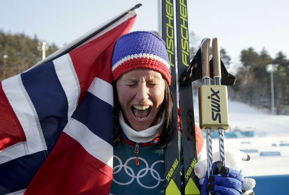 Norway's Marit Bjoergen, 37, sheds tears of happiness after winning her 15th medal, most in Winter Games history. Photo: Dmitri Lovetsky, Associated Press