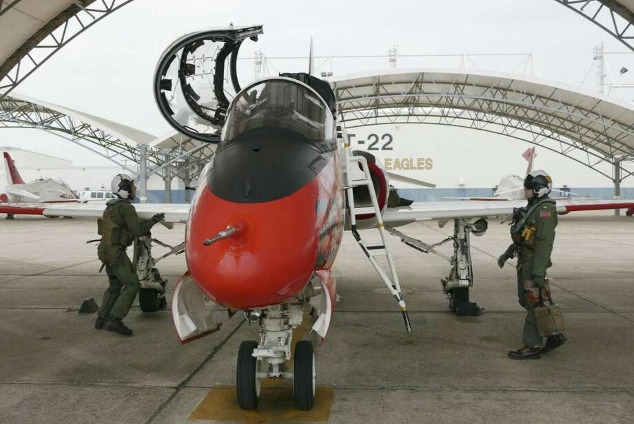 """Student pilot Lt. j.g. Joseph Puhr (left) and instructor pilot Lt. Johnathon """"Wheelie"""" Casey inspect a T-45C Goshawk before their flight at Naval Air Station Kingsville. A spike in hypoxia-like incidents led to the jet's grounding for three months last year.  Hypoxia is potentially fatal and easily confused with other altitude-related illnesses  on Tuesday, Feb. 20, 2018. The T-45 has been plagued with a problem in the crew's oxygen system, which has caused a condition called hypoxia, or lack of oxygen to the body. Photo: Photos By Billy Calzada /San Antonio Express-News / San Antonio Express-News"""