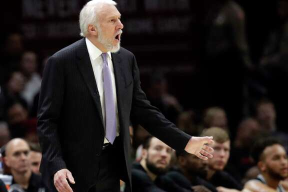 San Antonio Spurs head coach Gregg Popovich yells instructions to players in the first half of an NBA basketball game against the Cleveland Cavaliers, Sunday, Feb. 25, 2018, in Cleveland. (AP Photo/Tony Dejak)