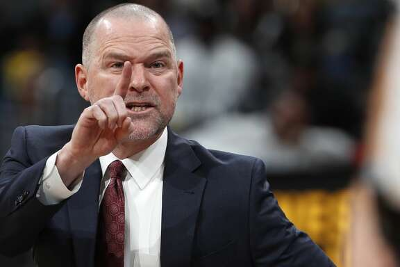 Denver Nuggets coach Michael Malone argues with referee J.T. Orr in the second half of the team's NBA basketball game against the San Antonio Spurs on Tuesday, Feb. 13, 2018, in Denver. The Nuggets won 117-109. (AP Photo/David Zalubowski)