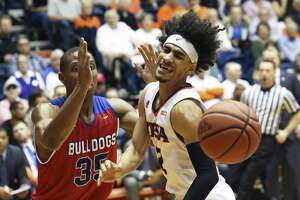 Jhivvan Jackson cringes coming off his knee on a move to the basket against Oliver Powell as UTSA  hosts Louisiana Tech at the UTSA Convocation Center on February 24, 2018.
