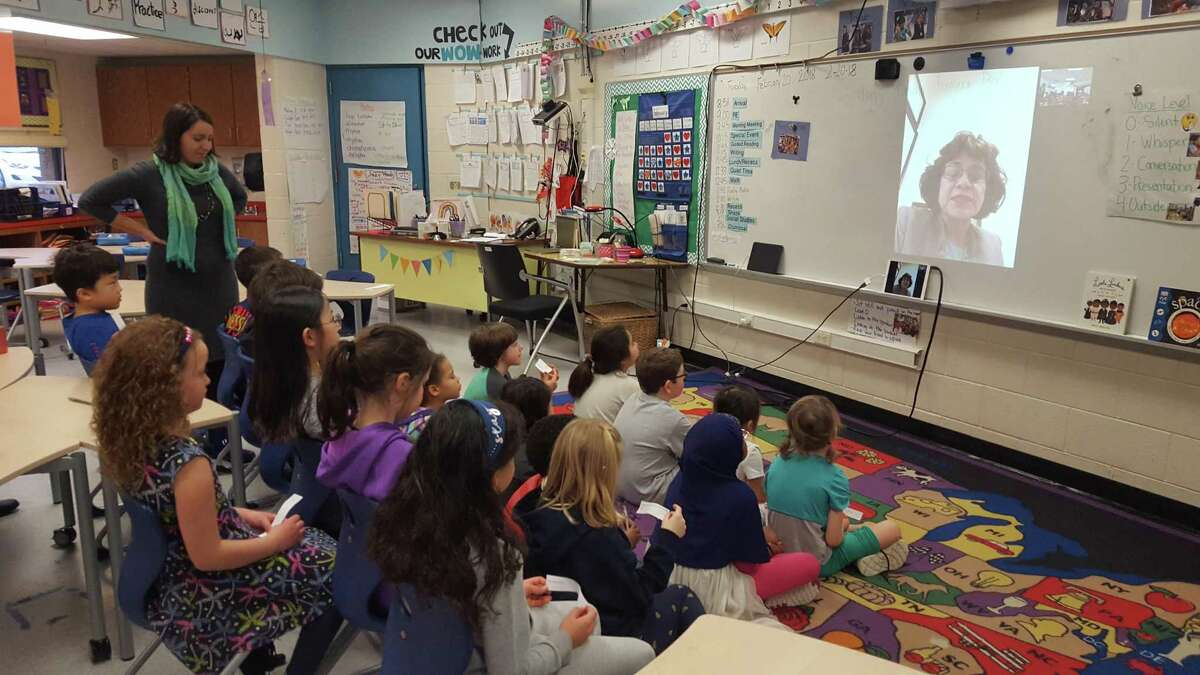 """Emma Gallo-Chasanoff, a teacher in Ann Arbor, Michigan, leads her second-graders in a question-and-answer sessions with San Antonio lawyer Sharyll Teneyuca, author of """"It's Not Fair! Emma Tenayuca's Struggle for Justice."""""""