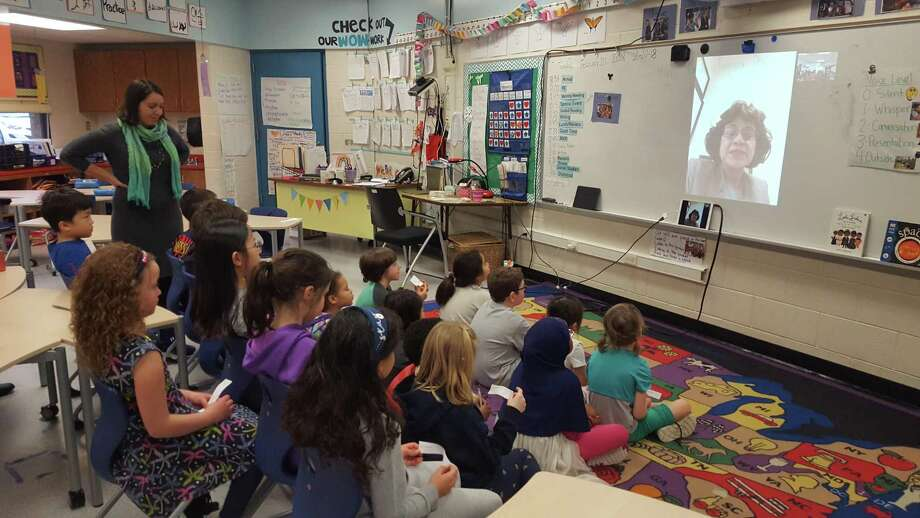 """Emma Gallo-Chasanoff, a teacher in Ann Arbor, Michigan, leads her second-graders in a question-and-answer sessions with San Antonio lawyer Sharyll Teneyuca, author of """"It's Not Fair! Emma Tenayuca's Struggle for Justice."""" Photo: Courtesy / Courtesy"""