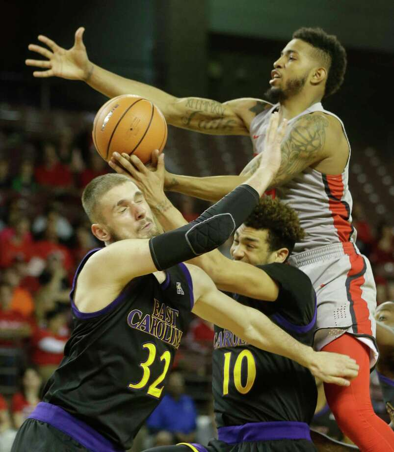 Senior forward Devin Davis, right, and UH played some stifling defense on Sunday, holding East Carolina to 22 percent shooting in the first half.  Photo: Melissa Phillip, Staff / © 2018 Houston Chronicle