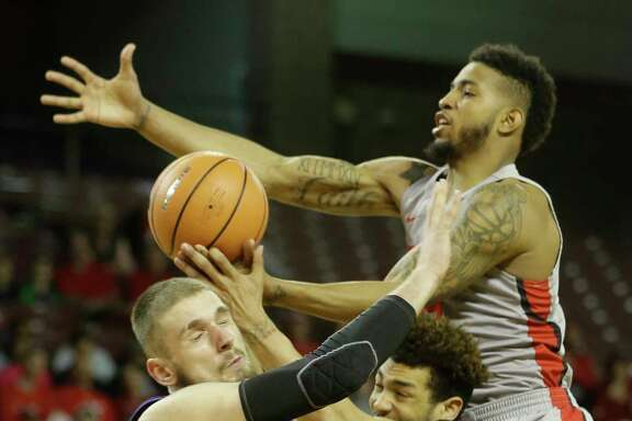 Senior forward Devin Davis, right, and UH played some stifling defense on Sunday, holding East Carolina to 22 percent shooting in the first half.