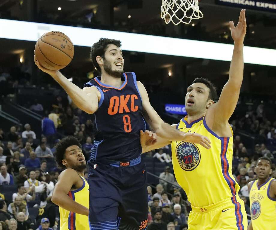 81c0cc2f65c Oklahoma City Thunder guard Alex Abrines (8) is pressured by Golden State  Warriors center