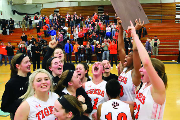The Edwardsville girls' basketball team celebrates after winning the Class 4A Champaign Centennial Sectional championship with a victory over Rock Island on Thursday.
