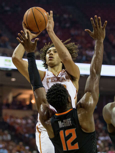 Filling in for the injured Mo Bamba, freshman Jericho Sims found himself a key piece for Texas in Saturday's 65-64 home win over Oklahoma State. Photo: Nick Wagner, MBO / Austin American-Statesman