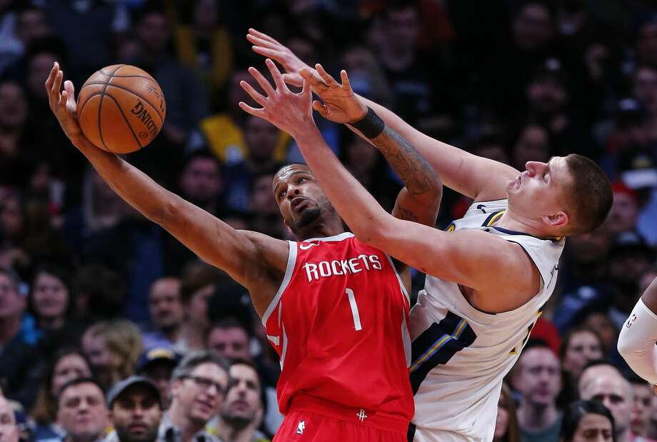 Houston Rockets forward Trevor Ariza (1) and Denver Nuggets center Nikola Jokic (15) reach for a rebound during the second quarter of an NBA basketball game, Sunday, Feb. 25, 2018, in Denver. (AP Photo/Jack Dempsey) Photo: Jack Dempsey/Associated Press