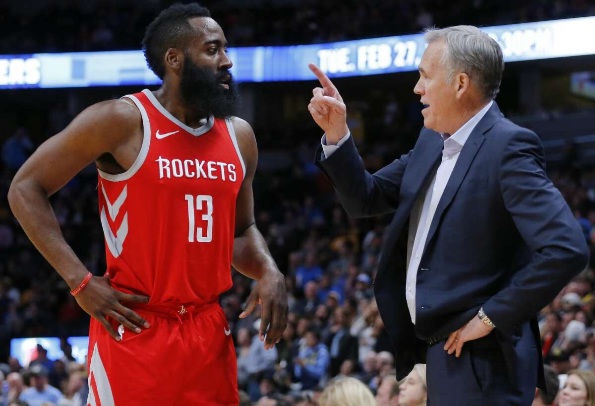 Houston Rockets guard James Harden (13) talks with Mike D'Antoni during the fourth quarter of an NBA basketball game against the Denver Nuggets, Sunday, Feb. 25, 2018, in Denver. (AP Photo/Jack Dempsey)