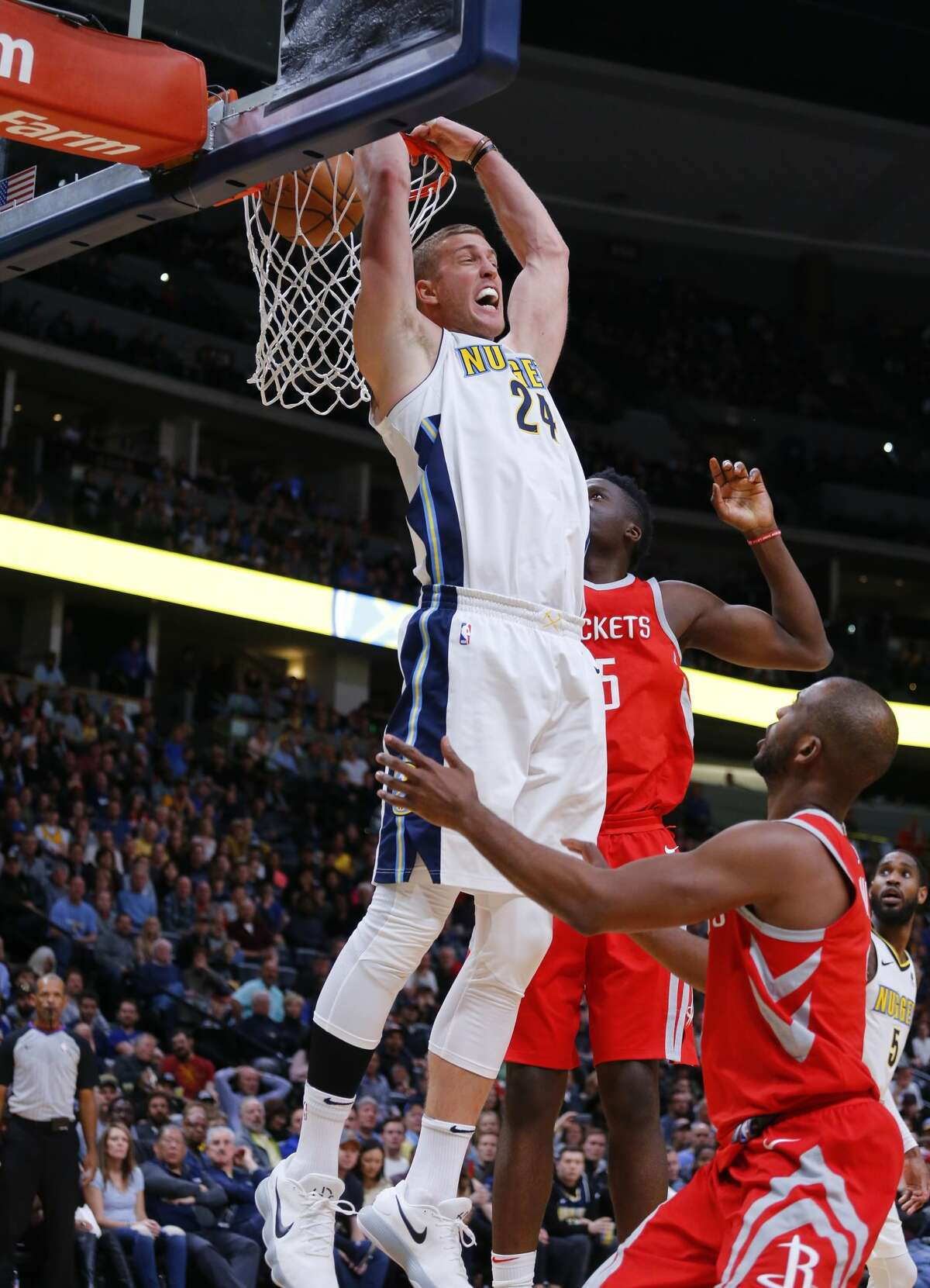 Denver Nuggets center Mason Plumlee (24) reverse dunks against the Houston Rockets during the fourth quarter of an NBA basketball game, Sunday, Feb. 25, 2018, in Denver. (AP Photo/Jack Dempsey)