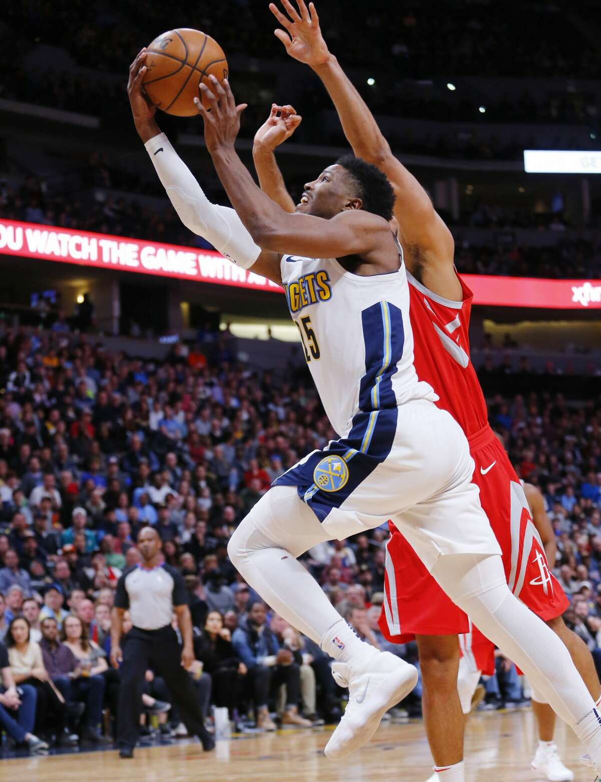 Denver Nuggets guard Malik Beasley (25) goes up for a shot against the against the Houston Rockets during the fourth quarter of an NBA basketball game, Sunday, Feb. 25, 2018, in Denver. (AP Photo/Jack Dempsey)
