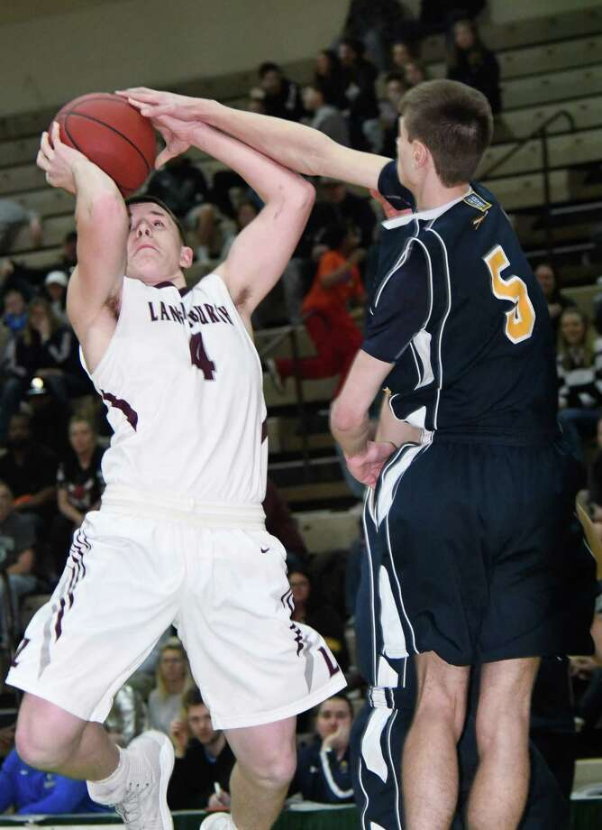 Averill Park's Zachary Price reaches a hand out to prevent Lansingburgh's Vinny Tario from shooting the ball during a game on Sunday, Feb. 25, 2018, as part of the Section II Tournament at Hudson Falls Community College in Troy, N.Y. (Jenn March, Special to the Times Union) Photo: Jenn March / 20042969A