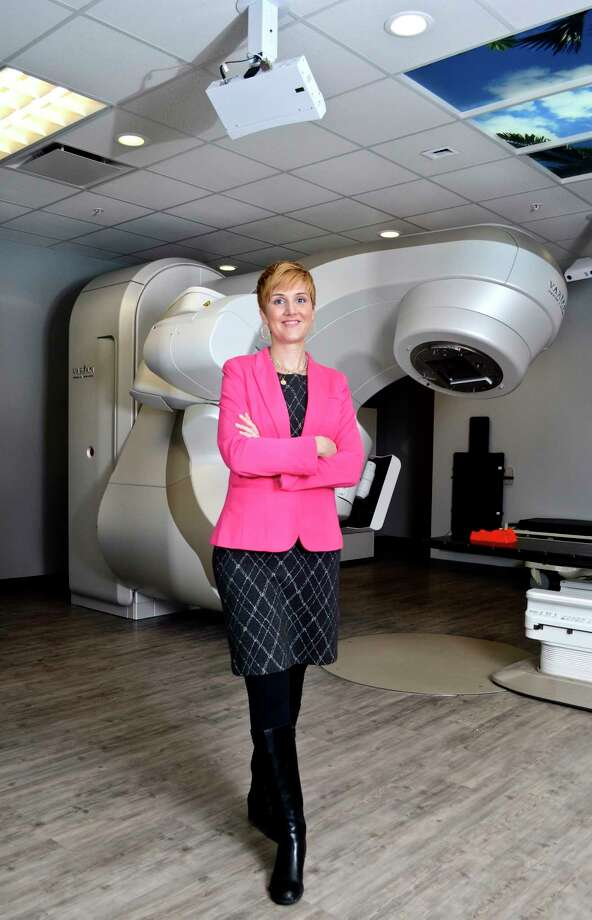 Megan Farrar, R.T., Director of Radiation and Imaging Services at New York Oncology Hematology, poses for a picture in front of a linear accelerator at NYOH in Clifton Park, NY, on Tuesday, January 30, 2018. (Photo by Colleen Ingerto / Times Union) Photo: Colleen Ingerto / Times Union