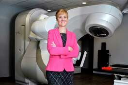 Megan Farrar, R.T., Director of Radiation and Imaging Services at New York Oncology Hematology, poses for a picture in front of a linear accelerator at NYOH in Clifton Park, NY, on Tuesday, January 30, 2018. (Photo by Colleen Ingerto / Times Union)