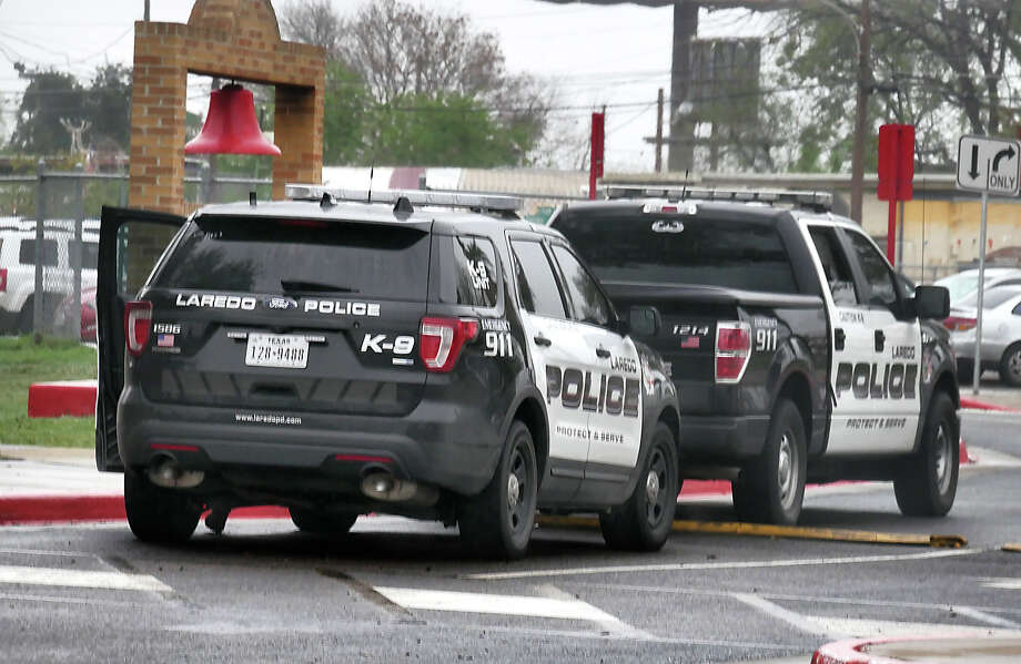 A pair of Laredo Police department Canine Units are parked outside the main entrance to Martin High School Friday, February 23, 2018, as the district conducted a lockdown drill. Law enforcement officers from the LISD, UISD, LPD, Webb County Sheriff's and Texas Parks and Wildlife participated in the drill. Photo: Cuate Santos, Laredo Morning Times / Laredo Morning Times