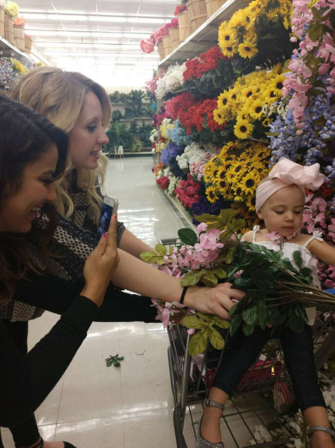 Swarms of teenagers and adults have descended on Hobby Lobby and Michael's stores to bury themselves in their fake flowers as part of the latest meme taking over the country. Photo: Twitter @McKennaWeeks